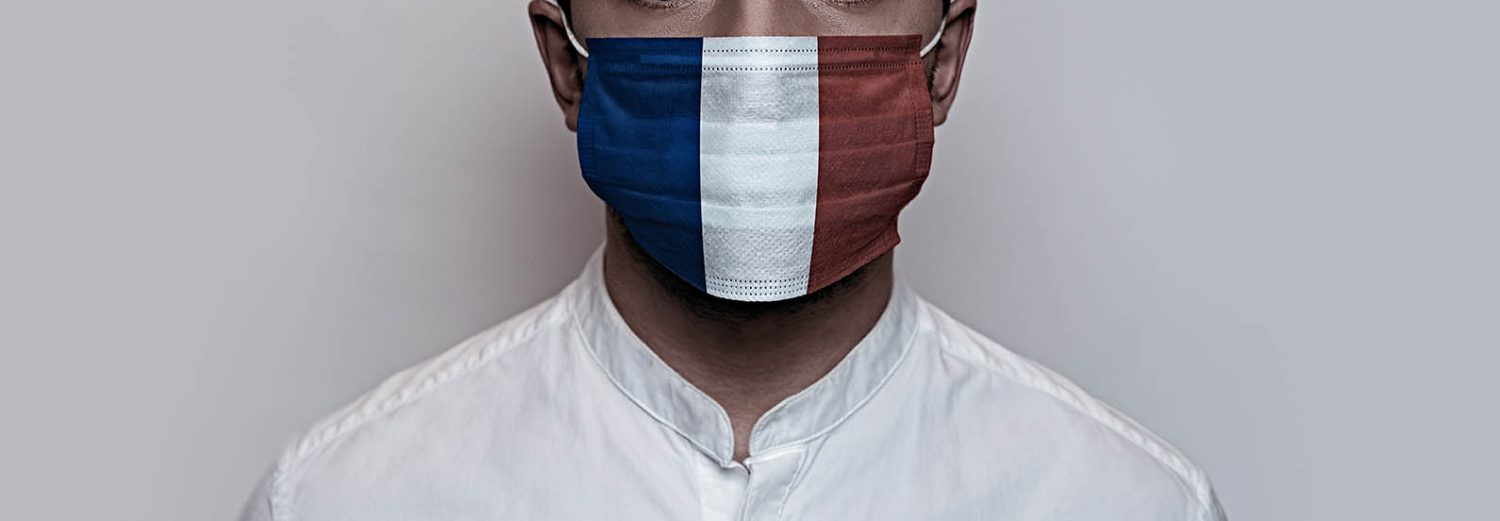 Man with a face mask with French flag